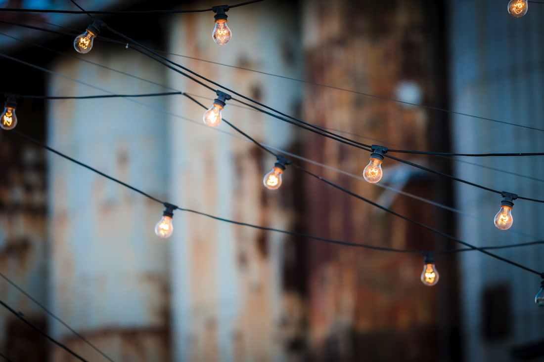 close up of illuminated lighting equipment against the sky