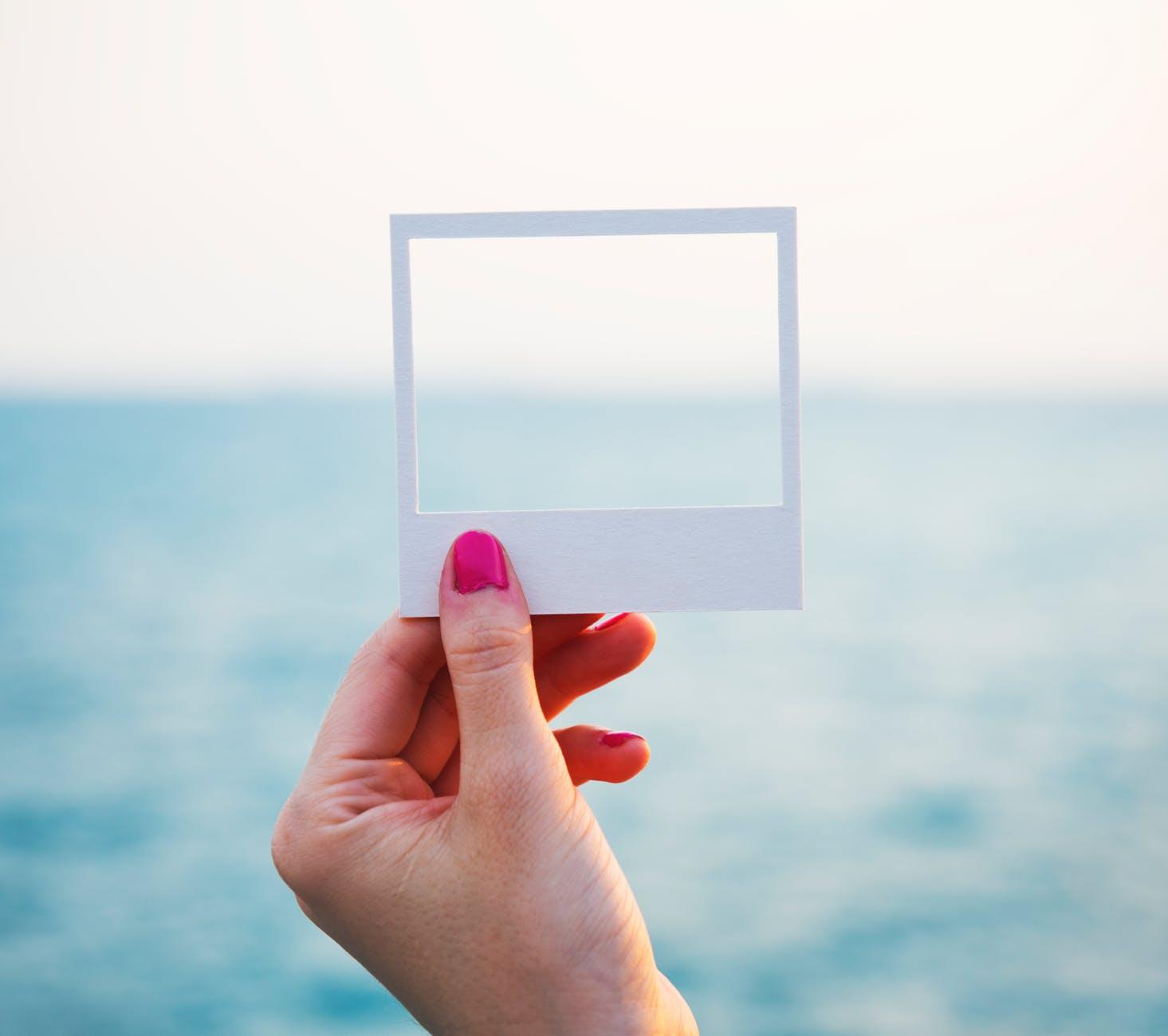 beach frame hand holding